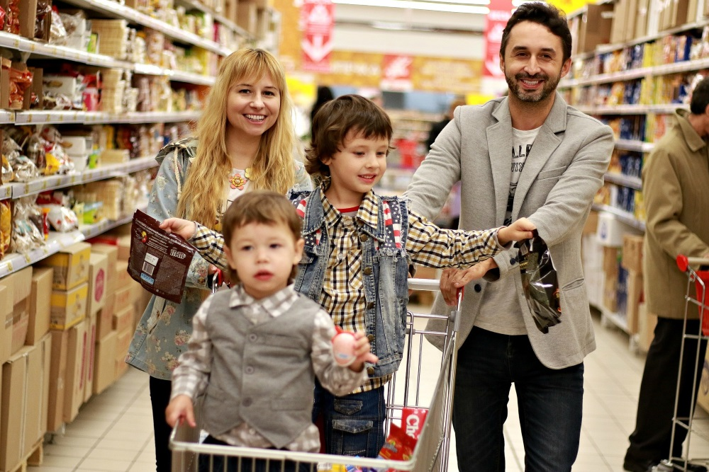 happy family shopping for food in a supermarket